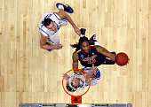 Jesse Perry of the Arizona Wildcats goes to the basket against Miles Plumlee and Kyle Singler of the Duke Blue Devils during the west regional...