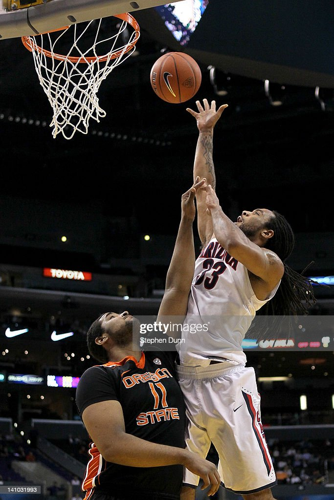 Jesse Perry #33 of the Arizona Wildcats shoots over Joe Burton #11 of the Oregon State Beavers in the second half in the semifinals of the 2012 Pacific Life Pac-12 men's basketball tournament at Staples Center on March 9, 2012 in Los Angeles, California.