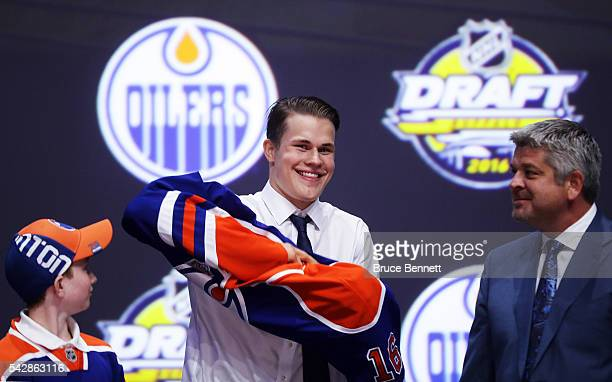 Jesse Puljujarvi celebrates after being selected fourth overall by the Edmonton Oilers during round one of the 2016 NHL Draft on June 24 2016 in...