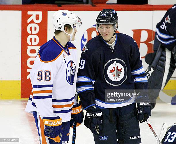 Jesse Puljujarvi of the Edmonton Oilers and Patrik Laine of the Winnipeg Jets share a laugh during the pregame warm up prior to NHL action at the MTS...