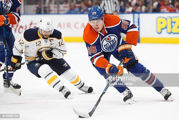 Jesse Puljujarvi of the Edmonton Oilers is pursued by Brian Gionta of the Buffalo Sabres on October 16 2016 at Rogers Place in Edmonton Alberta Canada
