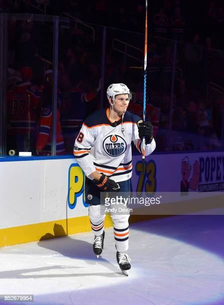 Jesse Puljujarvi of the Edmonton Oilers salutes the crowed after being selected as the first star of the game following the preseason game against...