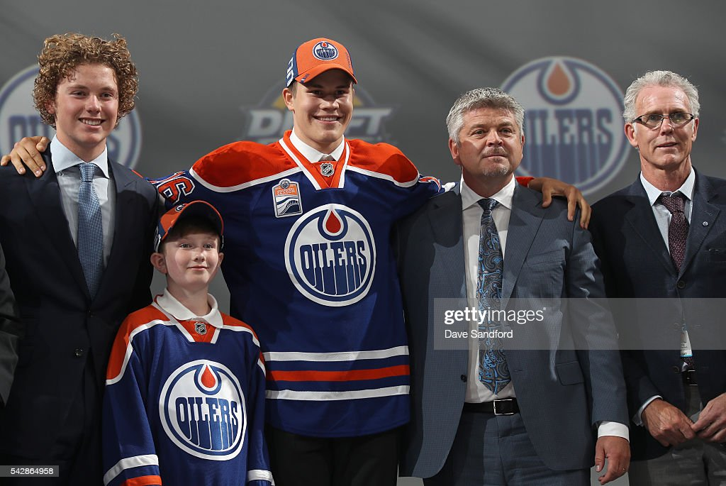 Jesse Puljujarvi poses for a photo with Edmonton Oilers team personnel after being selected fourth overall by the Edmonton Oilers during round one of the 2016 NHL Draft at First Niagara Center on June 24, 2016 in Buffalo, New York.