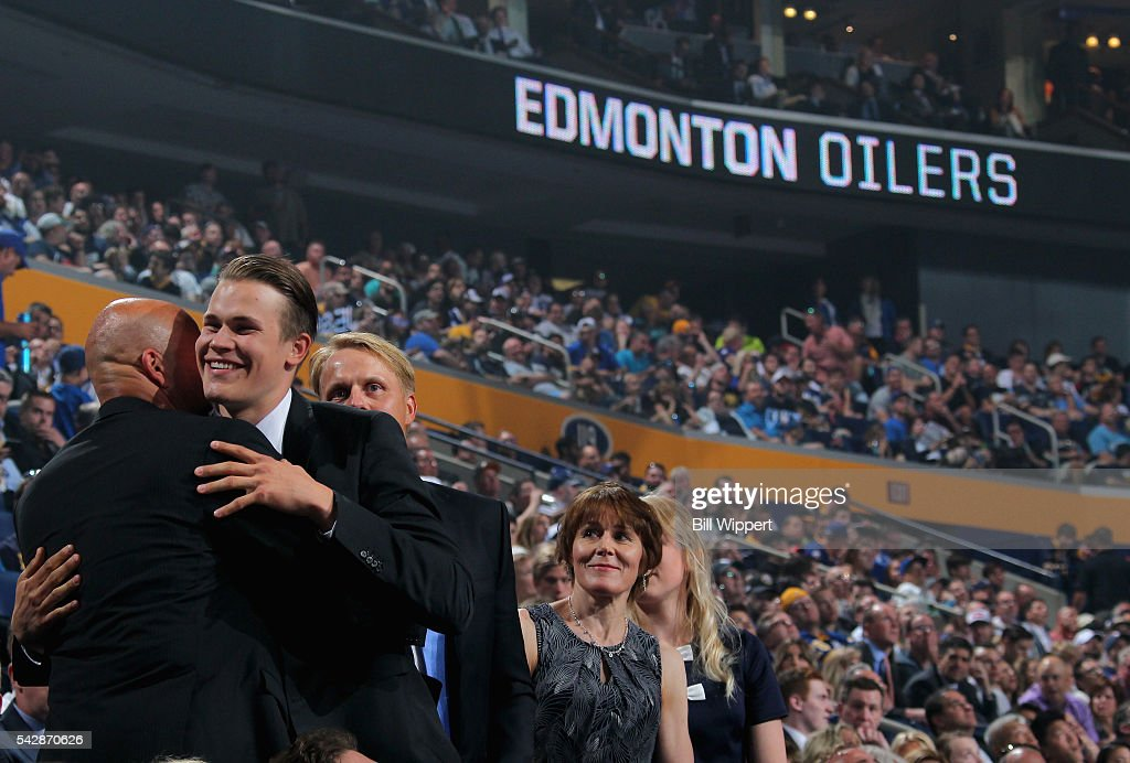 Jesse Puljujarvi reacts after being selected fourth overall by the Edmonton Oilers during round one of the 2016 NHL Draft at First Niagara Center on June 24, 2016 in Buffalo, New York.