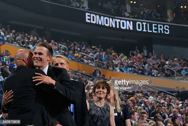 Jesse Puljujarvi reacts after being selected fourth overall by the Edmonton Oilers during round one of the 2016 NHL Draft at First Niagara Center on...