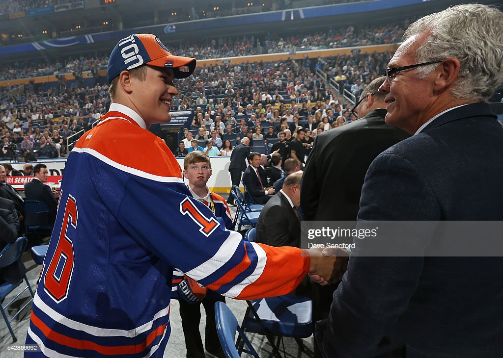 Jesse Puljujarvi shakes the hand of Craig MacTavish at the Oilers draft table after being selected fourth overall by the Edmonton Oilers during round one of the 2016 NHL Draft at First Niagara Center on June 24, 2016 in Buffalo, New York.