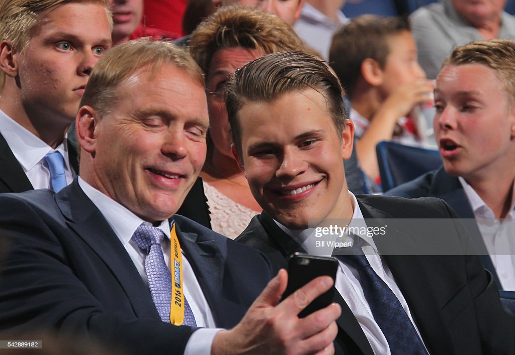 Jesse Puljujarvi sits with his agent, Markus Lehto, before being selected fourth overall by the Edmonton Oilers during round one of the 2016 NHL Draft at First Niagara Center on June 24, 2016 in Buffalo, New York.