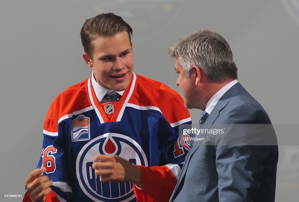 Jesse Puljujarvi speaks to head coach <a gi-track='captionPersonalityLinkClicked' href=/galleries/search?phrase=Todd+McLellan&family=editorial&specificpeople=543235 ng-click='$event.stopPropagation()'>Todd McLellan</a> after being selected fourth overall by the Edmonton Oilers during round one of the 2016 NHL Draft at First Niagara Center on June 24, 2016 in Buffalo, New York.