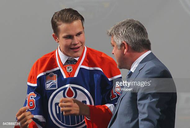 Jesse Puljujarvi speaks to head coach Todd McLellan after being selected fourth overall by the Edmonton Oilers during round one of the 2016 NHL Draft...