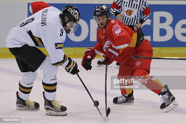 Jesse Puljujarvi with Puck versus Stephan Daschner during the Champions Hockey League round of thirtytwo game between Duesseldorfer EG and Karpat...