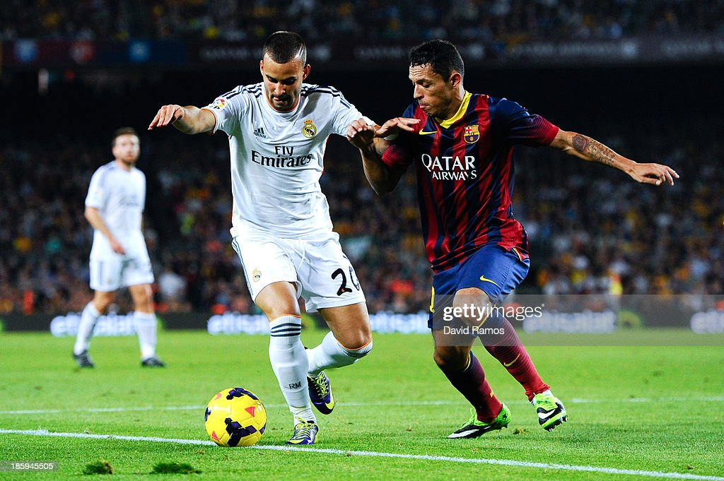 Jesse Rodriguez of Real Madrid CF duels for the ball with Adriano Correia of FC Barcelona during the La Liga match between FC Barcelona and Real Madrid CF at Camp Nou on October 26, 2013 in Barcelona, Spain.
