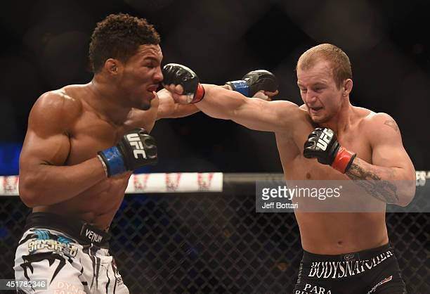 Jesse Ronson punches Kevin Lee in their flyweight fight during the Ultimate Fighter Finale inside the Mandalay Bay Events Center on July 6 2014 in...