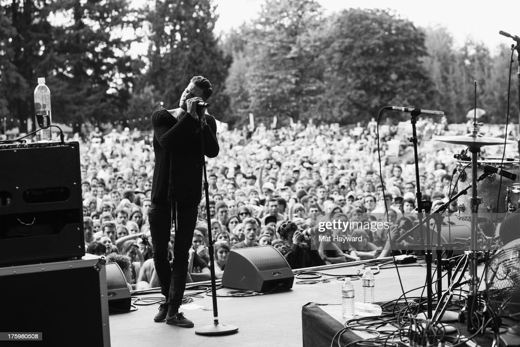 Jesse Rutherford of the Neighbourhood performs on stage during Summer Camp hosted by 107.7 The End at Marymoor Park on August 10, 2013 in Seattle, Washington.