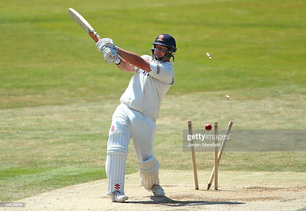 Jesse Ryder of Essex is bowled out by Mitchell Starc of Australia during day four of the tour match between Essex and Australia at The Essex County...
