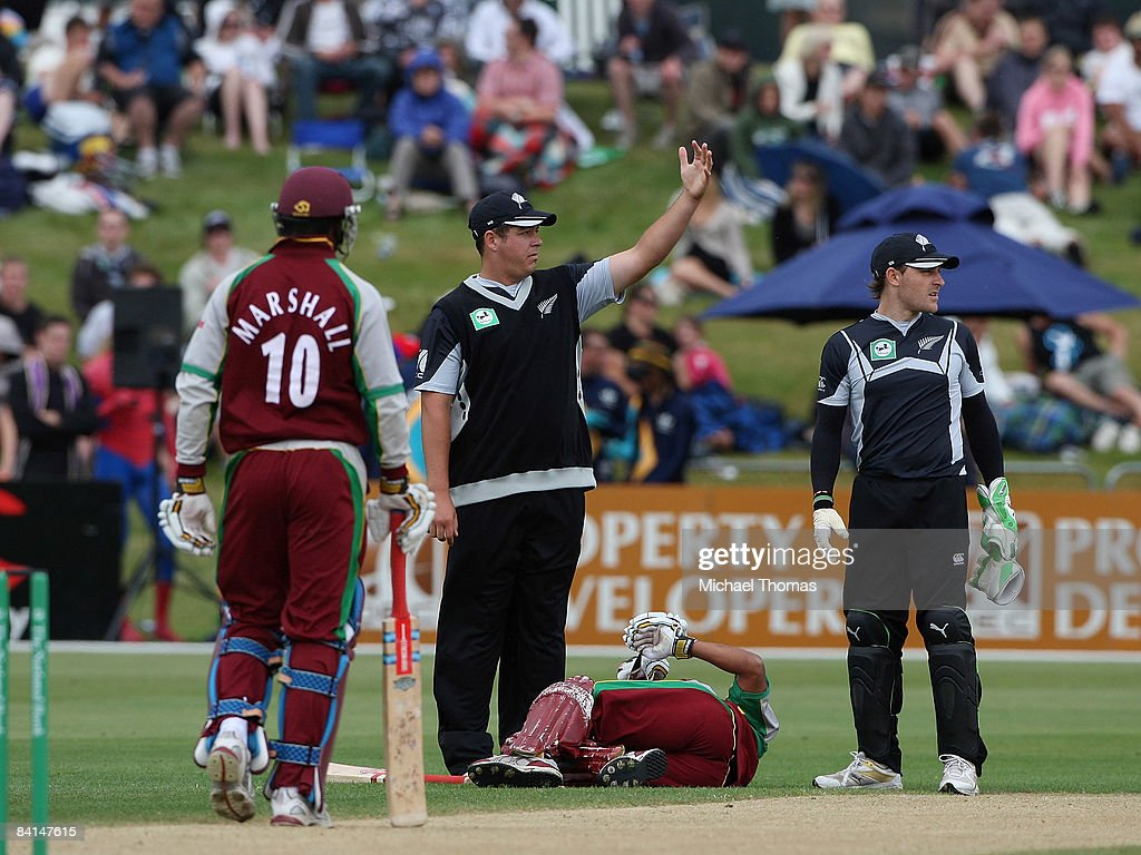 Jesse Ryder of New Zealand calls for help for the injured Ramnaresh Sarwan of the West Indies during the First One Day International Match between...