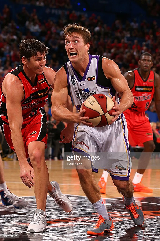 Jesse Sanders of the Kings goes to the basket against Damian Martin of the Wildcats during the round two NBL match between the Perth Wildcats and the Sydney Kings at Perth Arena in October 18, 2013 in Perth, Australia.