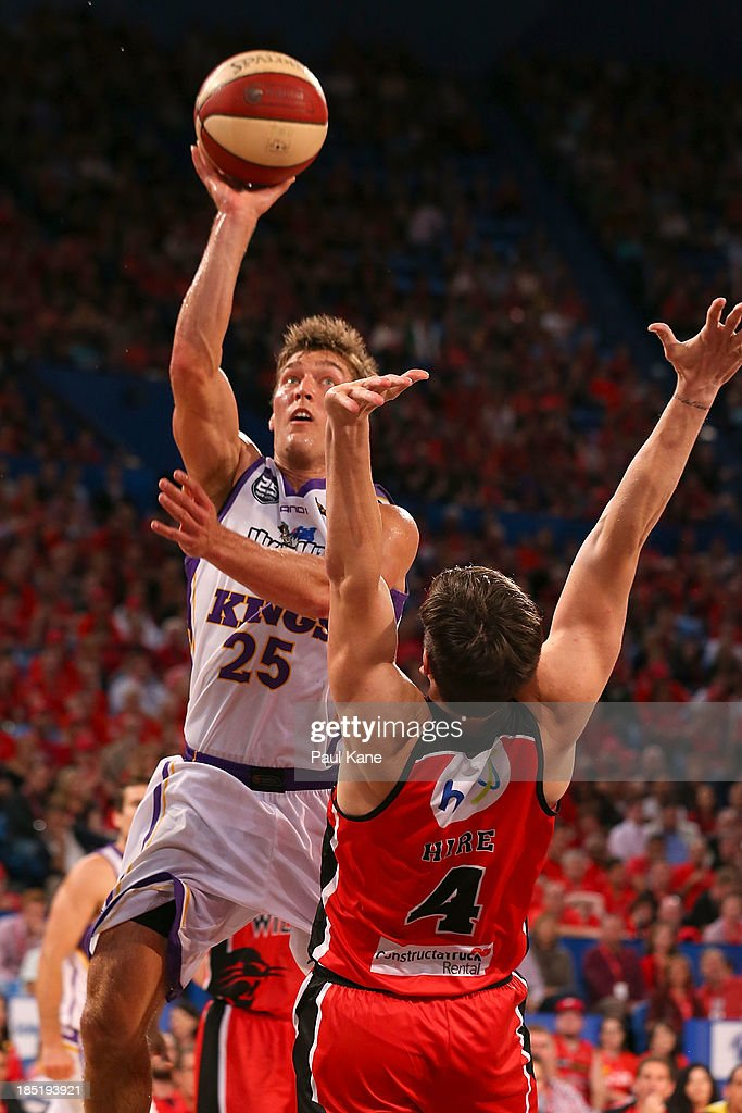 Jesse Sanders of the Kings lays up against Greg Hire of the Wildcats during the round two NBL match between the Perth Wildcats and the Sydney Kings at Perth Arena in October 18, 2013 in Perth, Australia.