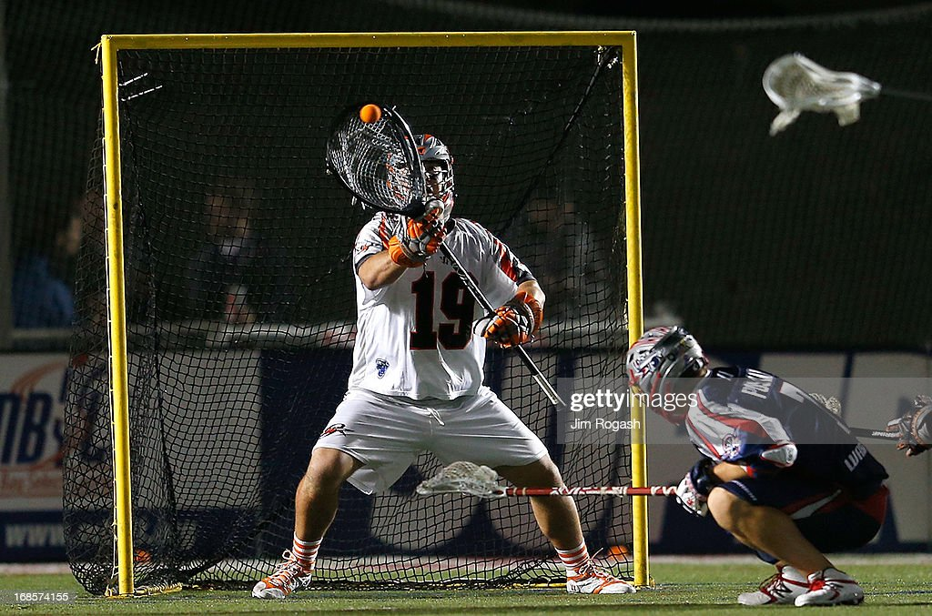Jesse Schwartzman #19, goalie for the Denver Outlaws, makes a save in the second half against the Boston Cannons at Harvard Stadium on May 11, 2013 in Boston, Massachusetts.