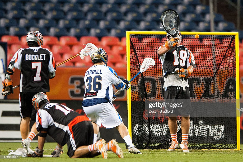 Jesse Schwartzman #19 of the Denver Outlaws blocks a close-range shot by <a gi-track='captionPersonalityLinkClicked' href=/galleries/search?phrase=Brian+Carroll&family=editorial&specificpeople=630651 ng-click='$event.stopPropagation()'>Brian Carroll</a> #36 of the Charlotte Hounds during a Major League Lacrosse game at Sports Authority Field at Mile High on June 29, 2013 in Denver, Colorado. The Outlaws beat the Hounds 17-11 and improved to 9-0 on the season.