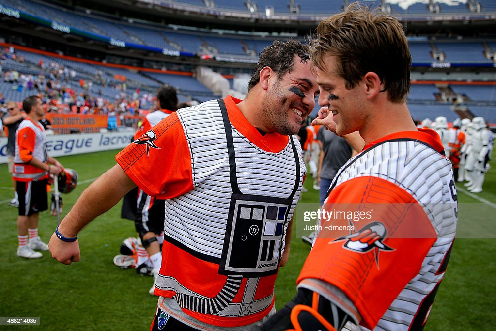 Jesse Schwartzman #19 of the Denver Outlaws celebrates the win against the Ohio Machine with teammate Drew Snider #23 at Sports Authority Field at Mile High on May 4, 2014 in Denver, Colorado. The teams wore Star Wars themed jerseys in honor of 'May-The-4th-Be-With-You' day.The Outlaws defeated the Machine 14-12.