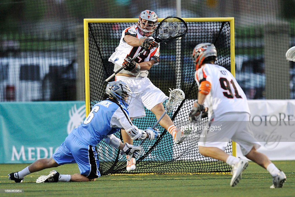 Jesse Schwartzman #19 of the Denver Outlaws defends against a shot attempt from Steele Stanwick #6 of the Ohio Machine in the first period on May 4, 2013 at Selby Stadium in Delaware, Ohio. Denver defeated Ohio 13-8.