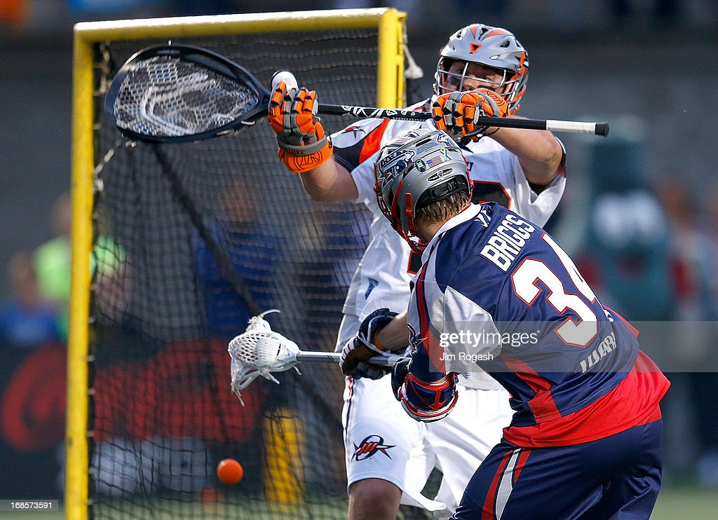 Jesse Schwartzman #19 of the Denver Outlaws does not stop a shot by Colin Briggs #34 of the Boston Cannons in the first half at Harvard Stadium on May 11, 2013 in Boston, Massachusetts.