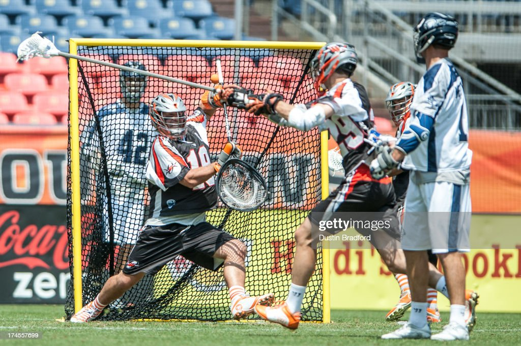 Jesse Schwartzman #19 of the Denver Outlaws makes a save against the Chesapeake Bayhawks in the second half during a Major League Lacrosse game at Sports Authority Field at Mile High on July 27, 2013 in Denver, Colorado. The Outlaws beat the Bayhawks 14-12.