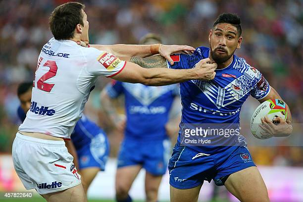 Jesse SeneLefao of Samoa fends Joel Tomkins of England during the Four Nations match between England and Samoa at Suncorp Stadium on October 25 2014...