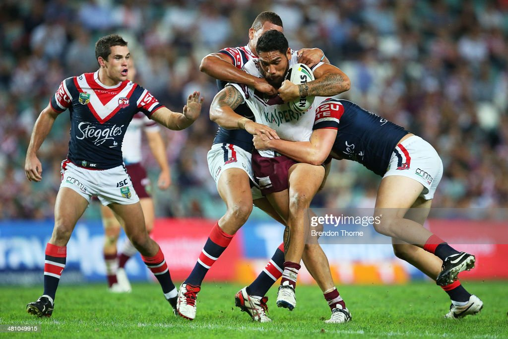 Jesse Sene-Lefao of the Sea Eagles is tackled by the Roosters defence during the round four NRL match between the Sydney Roosters and the Manly-Warringah Sea Eagles at Allianz Stadium on March 28, 2014 in Sydney, Australia.