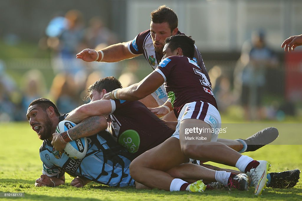 Jesse Sene-Lefao of the Sharks is tackled short of the try line during the NRL Trial match between the Cronulla Sharks and the Manly Sea Eagles at Remondis Stadium on February 14, 2016 in Sydney, Australia.