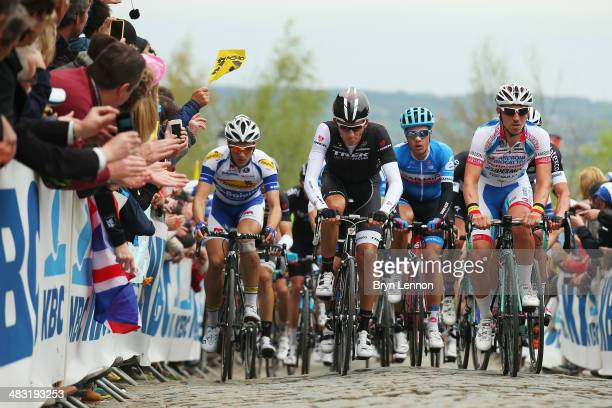 Jesse Sergent of Belgium and the Trek Factory Racing team leads the peloton up the Kwaremont during the 98th Tour of Flanders from Bruges to...