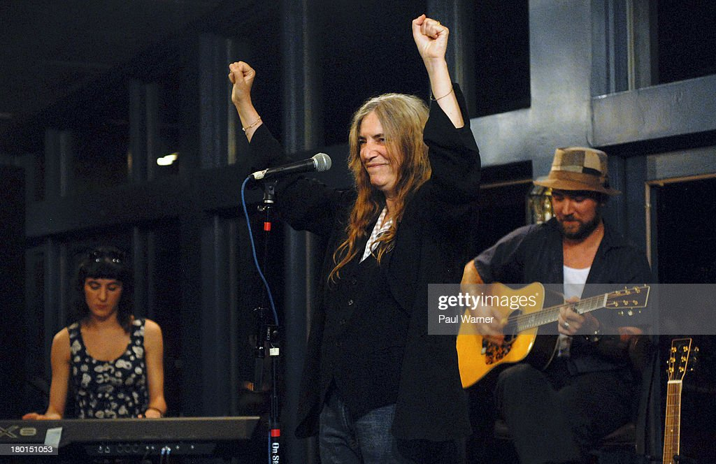 Jesse Smith (L), and Jackson Smith (R) perform with their mother Patti Smith (C) during a benefit concert for Covenant House Michigan, a homeless shelter for children, at Sinbad's on September 8, 2013 in Detroit, Michigan.
