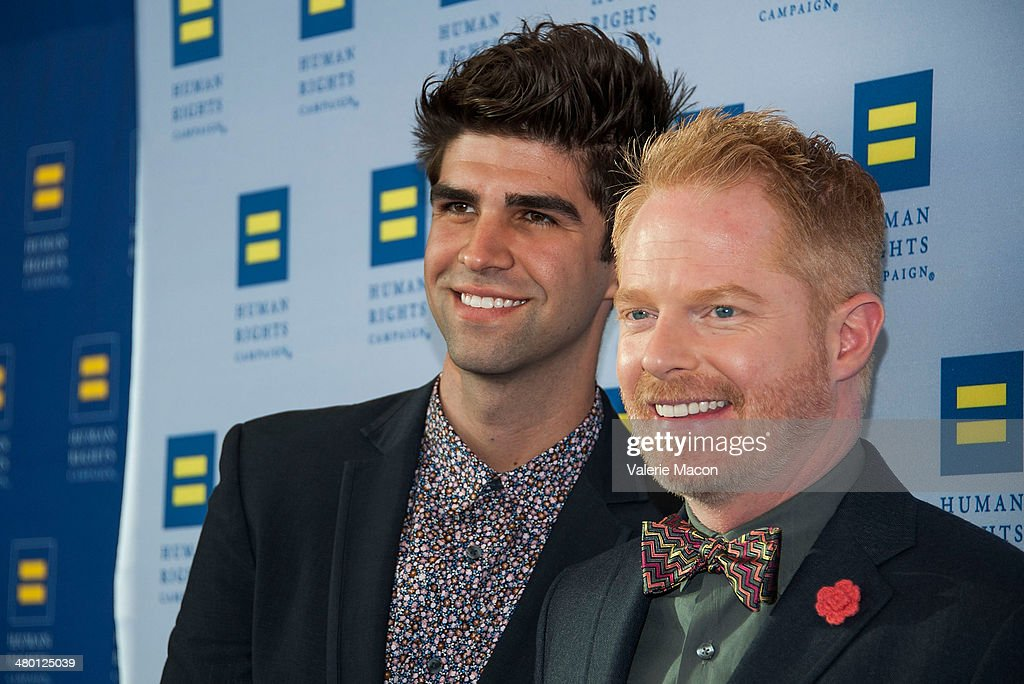 <a gi-track='captionPersonalityLinkClicked' href=/galleries/search?phrase=Jesse+Tyler+Ferguson&family=editorial&specificpeople=633114 ng-click='$event.stopPropagation()'>Jesse Tyler Ferguson</a> (L) and husband <a gi-track='captionPersonalityLinkClicked' href=/galleries/search?phrase=Justin+Mikita&family=editorial&specificpeople=7458663 ng-click='$event.stopPropagation()'>Justin Mikita</a> arrive at the Human Rights Campaign Los Angeles Gala Dinner at JW Marriott Los Angeles at L.A. LIVE on March 22, 2014 in Los Angeles, California.