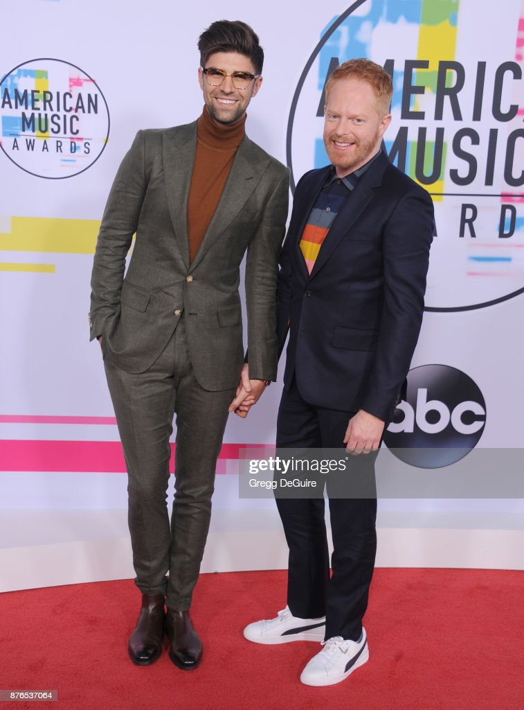 Jesse Tyler Ferguson and Justin Mikita arrive at the 2017 American Music Awards at Microsoft Theater on November 19, 2017 in Los Angeles, California.