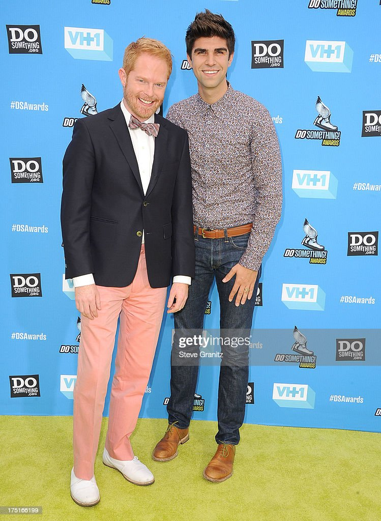 Jesse Tyler Ferguson and Justin Mikita arrives at the 2013 Do Something Awards at Avalon on July 31, 2013 in Hollywood, California.