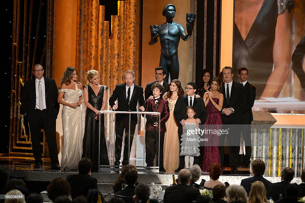 Jesse Tyler Ferguson (speaking), Sofía Vergara, Julie Bowen, Eric Stonestreet, and the rest of the 'Modern Family' cast accept the award for Outstanding Performance by an Ensemble in a Comedy Series onstage during the 19th Annual Screen Actors Guild Awards held at The Shrine Auditorium on January 27, 2013 in Los Angeles, California.