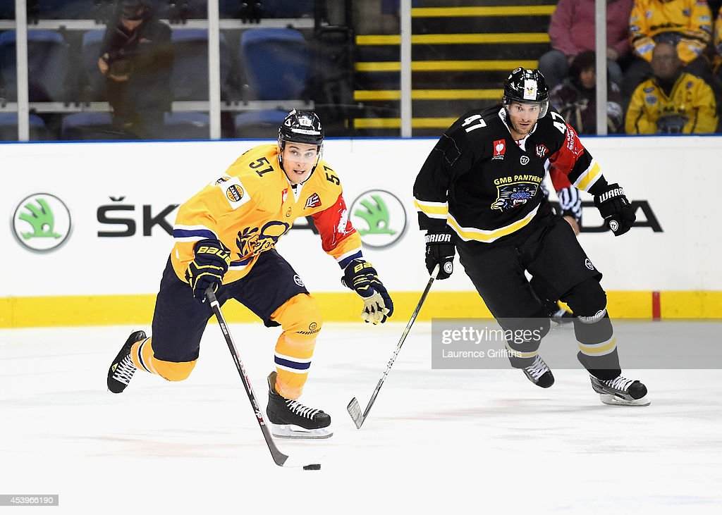 Jesse Virtanen of Lukko breaks from Martin Podlesak of Nottingham Panthers during the Champions Hockey League group stage game between Nottingham Panthers and Lukko Rauma on August 22, 2014 in Nottingham, England.
