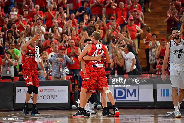 Jesse Wagstaff and Shawn Redhage of the Perth Wildcats react after the final siren during the round 17 NBL match between the Perth Wildcats and...