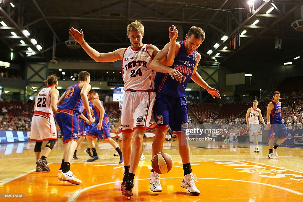 Jesse Wagstaff of Perth locks arms with Anthony Petrie of Adelaide during the round ten NBL match between the Adelaide 36ers and the Perth Wildcats at Adelaide Arena on December 9, 2012 in Adelaide, Australia.