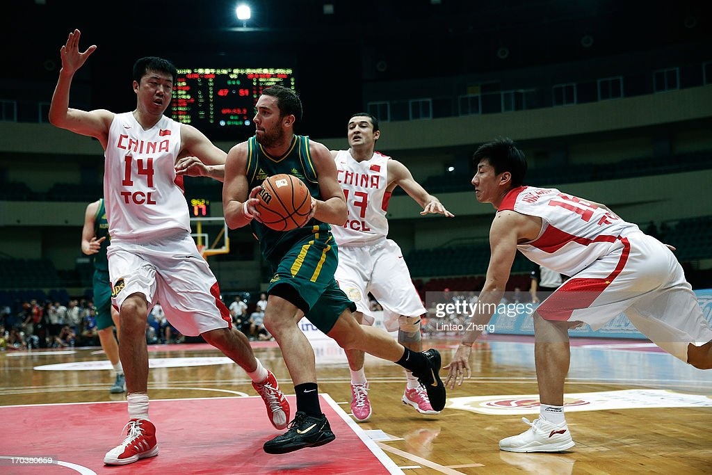 Jesse Wagstaff #11 of the Boomers brings the ball up the court with <a gi-track='captionPersonalityLinkClicked' href=/galleries/search?phrase=Wang+Zhizhi&family=editorial&specificpeople=206930 ng-click='$event.stopPropagation()'>Wang Zhizhi</a> (L), Xi Rilijiang and Zhou Peng of China during game three of the series between the Australian Boomers and China at Tianjin Sports Center on June 12, 2013 in Tianjin, China.
