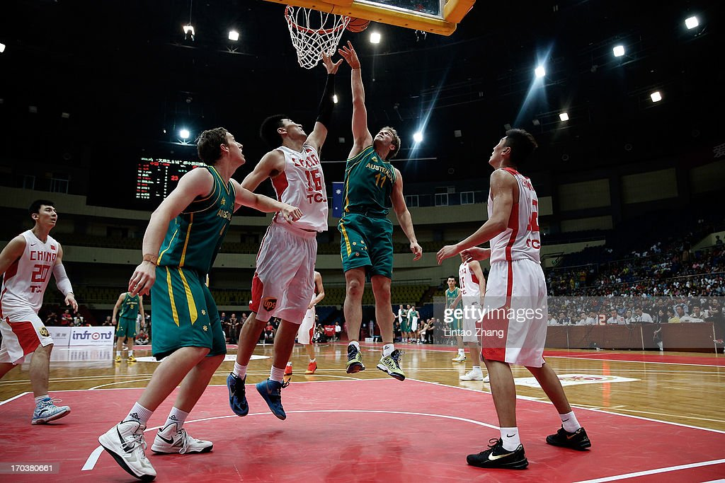 Jesse Wagstaff #11 of the Boomers drives to the basket against Li Xiaoxu of China (R) during game three of the series between the Australian Boomers and China at Tianjin Sports Center on June 12, 2013 in Tianjin, China.