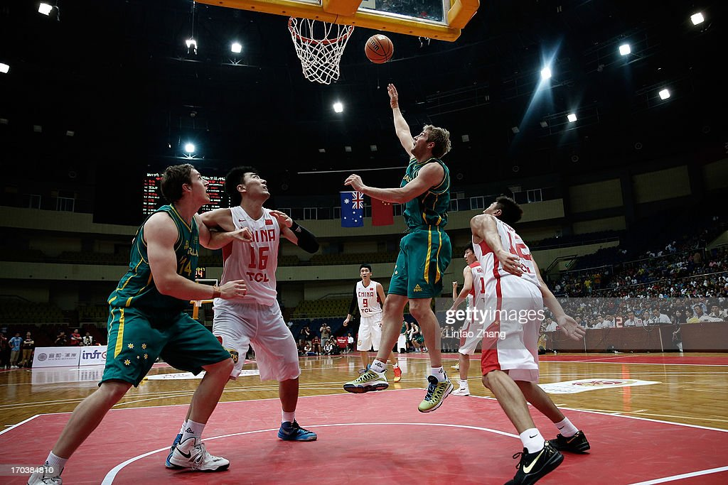 Jesse Wagstaff of the Boomers drives to the basket during game three of the series between the Australian Boomers and China at Tianjin Sports Center on June 12, 2013 in Tianjin, China.