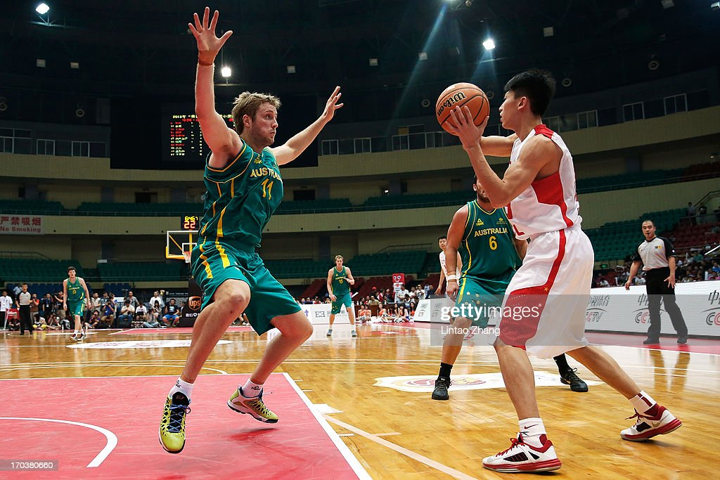 Jesse Wagstaff (L) of the Boomers holds out Zhou Peng of china during game three of the series between the Australian Boomers and China at Tianjin Sports Center on June 12, 2013 in Tianjin, China.