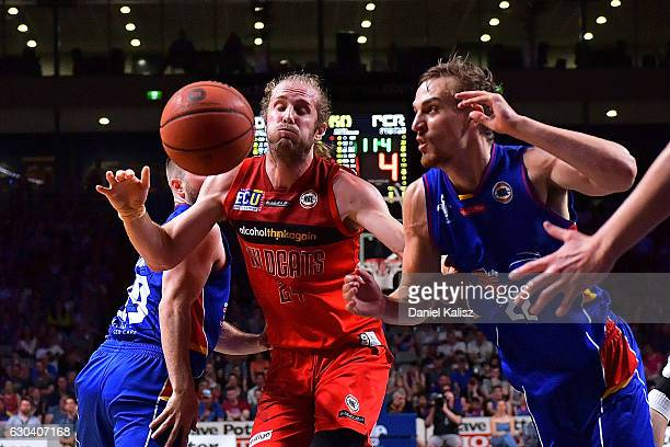 Jesse Wagstaff of the Perth Wildcats competes for the ball with Anthony Drmic of the Adelaide 36ers during the round 12 NBL match between the...