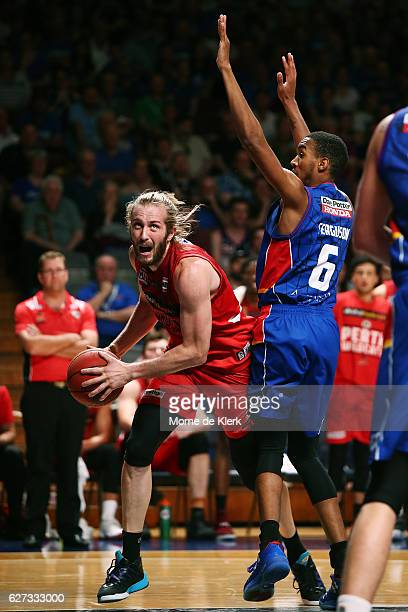 Jesse Wagstaff of the Perth Wildcats is blocked by Terrance Ferguson of the Adelaide 36ers during the round nine NBL match between the Adelaide 36ers...