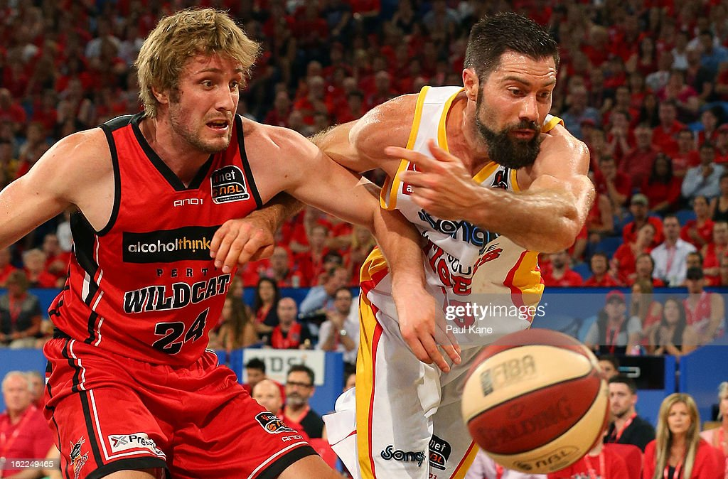 Jesse Wagstaff of the Wildcats and Liam Rush of the Tigers contest for a loose ball during the round 20 NBL match between the Perth Wildcats and the Melbourne Tigers at Perth Arena on February 21, 2013 in Perth, Australia.