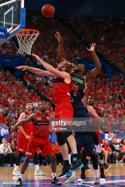 Jesse Wagstaff of the Wildcats and Tony Mitchell of the Taipans contest for a rebound during the game two NBL Semi Final match between the Perth...