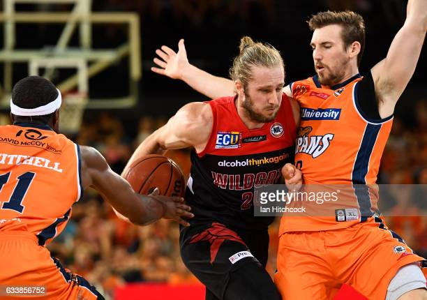 Jesse Wagstaff of the Wildcats attempts to drive past Mitch McCarron of the Taipans during the round 18 NBL match between the Cairns Taipans and the...