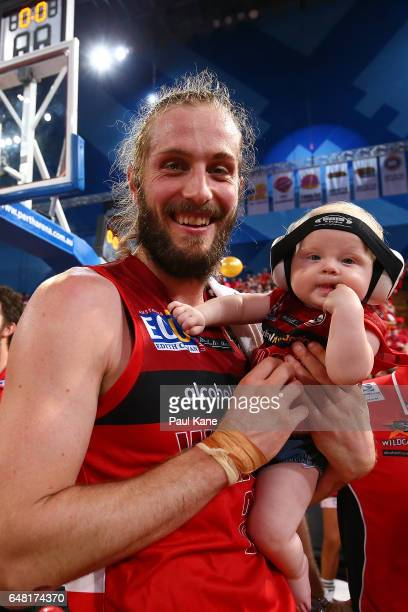 Jesse Wagstaff of the Wildcats celebrates with his daughter Kensington after winning game three and the NBL Grand Final series between the Perth...