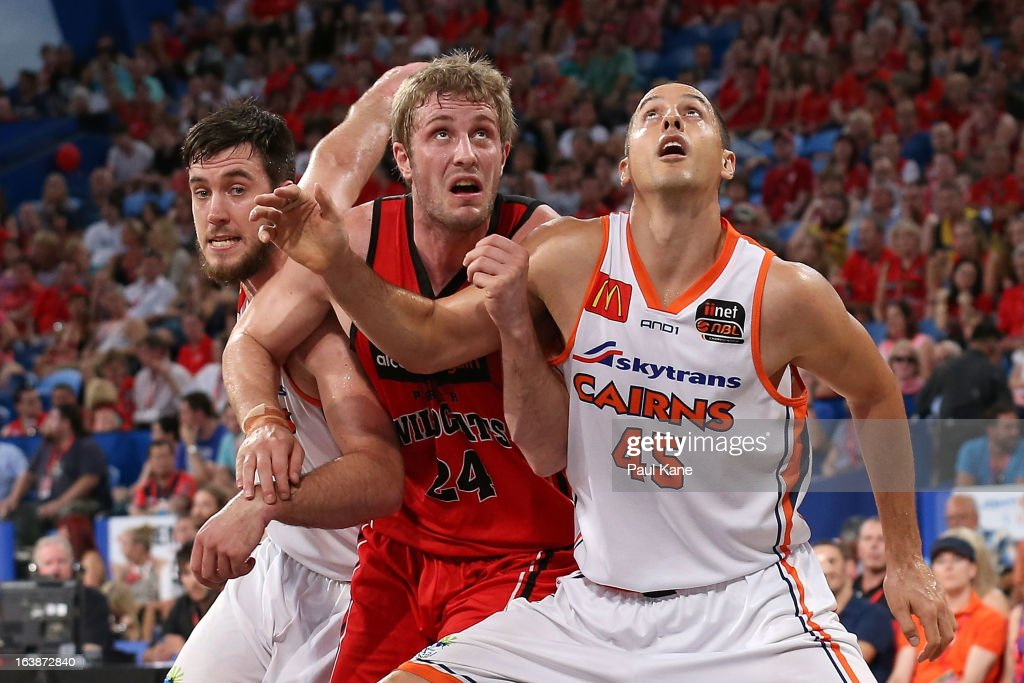 Jesse Wagstaff of the Wildcats contests position at free throw against Brad Hill and Dusty Rychart of the Taipans during the round 23 NBL match between the Perth Wildcats and the Cairns Taipans at Perth Arena on March 17, 2013 in Perth, Australia.